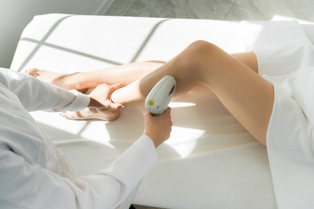 Women is getting Laser Hair Removal Treatment