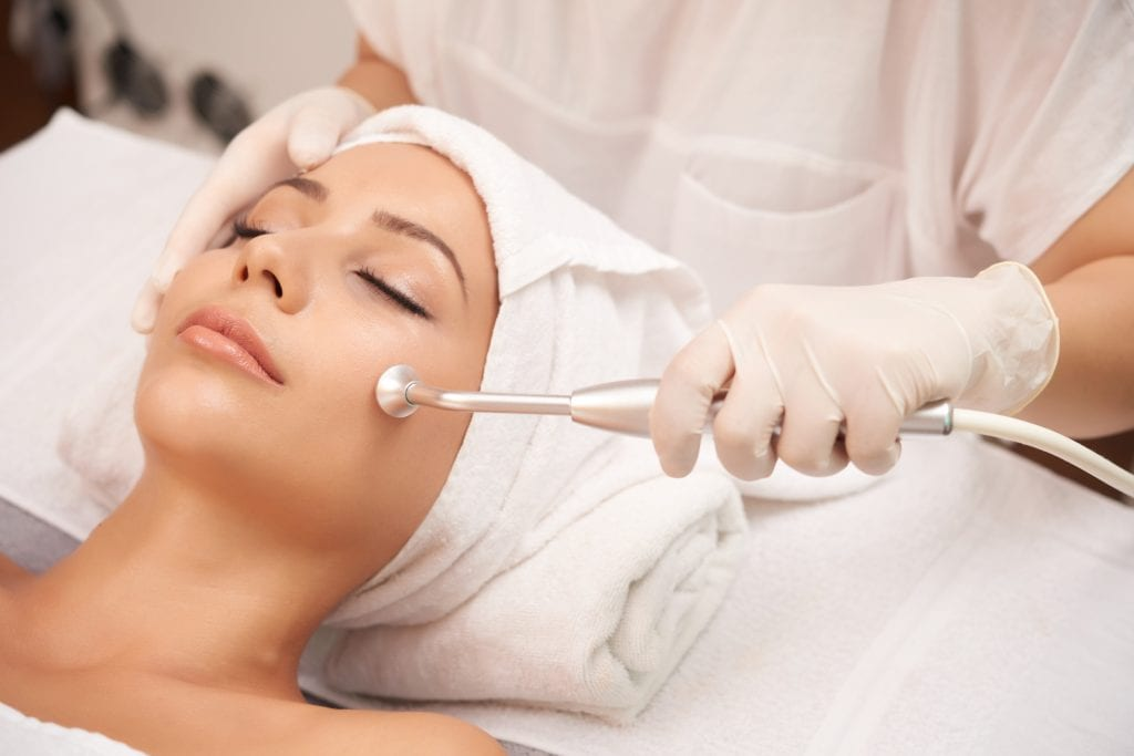 Microdermabrasion treatment on women's face