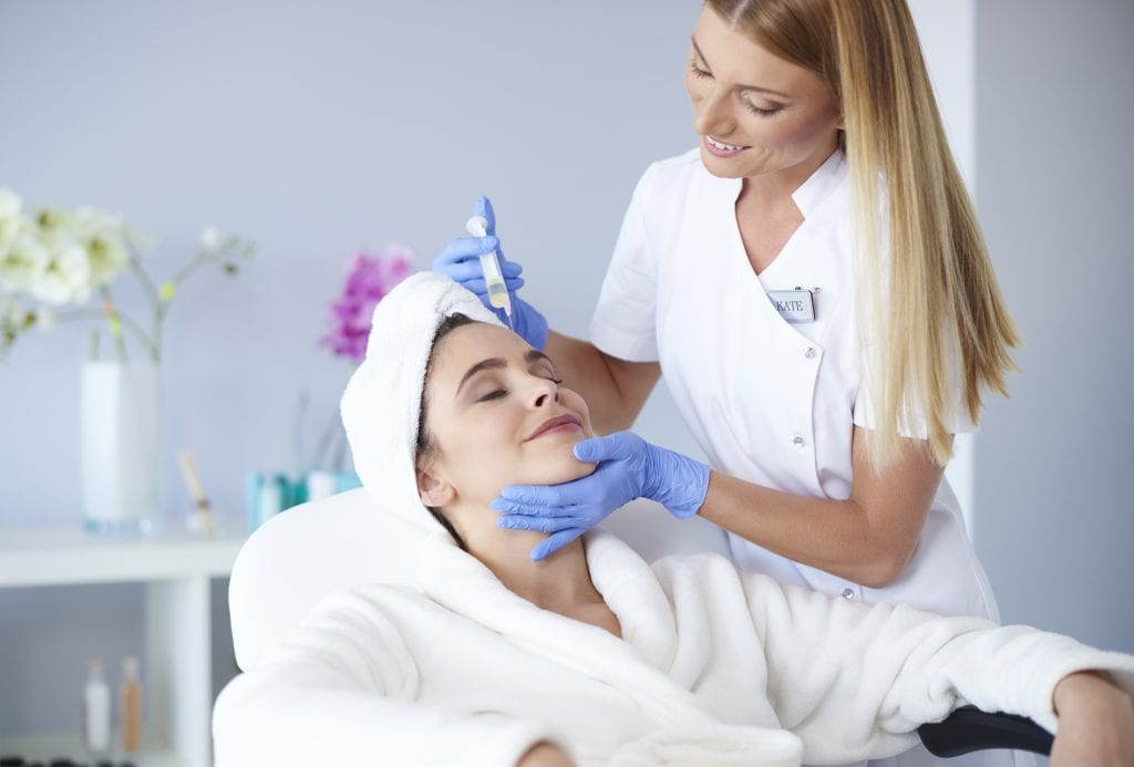 A trained medical professional providing Botox Injection