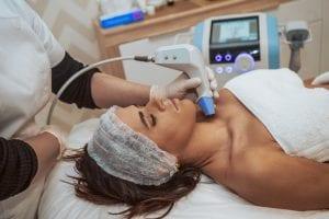 Women getting BTL Exilis ultracosmetic treatment