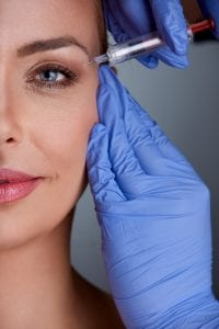 Middle Age Woman Getting Botox Treatment