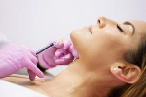 Doctor Injecting Botox Into The Chin